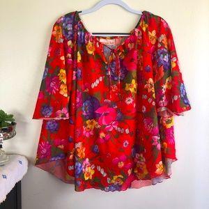 Floral flutter-sleeve blouse with lettuce hem